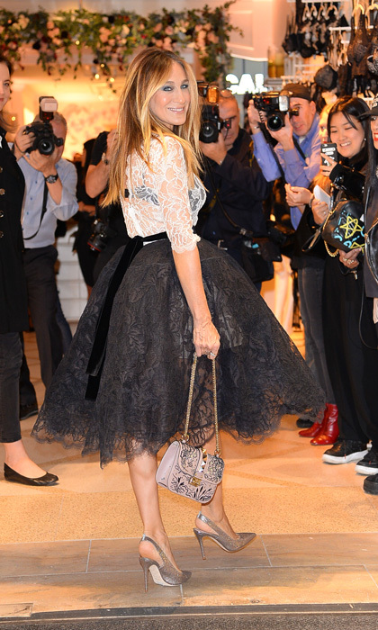 Sarah Jessica Parker looked like she stepped right off of the <i>Sex and the City</i> set as she left the Intimissimi store opening in NYC. The shoe designer paired her heels with a full skirt and lace top that showed her black bra.