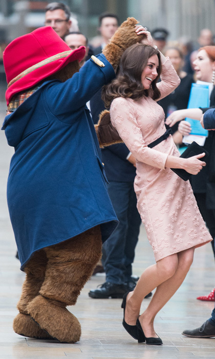 Kate Middleton shared a dance with Paddington Bear during a surprise appearance on October 16 at the Charities Forum event at London's Paddington train station. The Duchess of Cambridge joined Princes William and Harry at the engagement where they met with children on board the Belmond British Pullman Train. 
