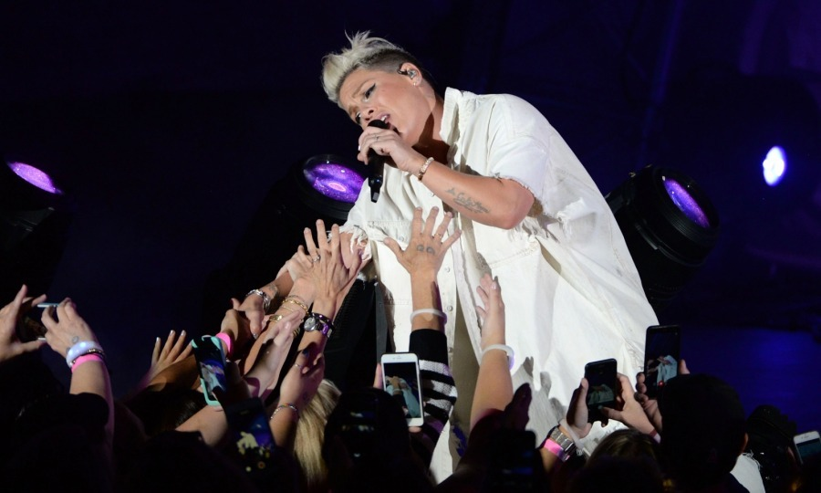 Pink also gave a high-energy performance onstage during the CBS Radio show. She got up close and personal with fans at the concert, looking fierce in a gnarly ripped denim outfit. The star flashed her legs in torn jeans, wearing an all-white ensemble that matched nicely with her platinum blonde hair.