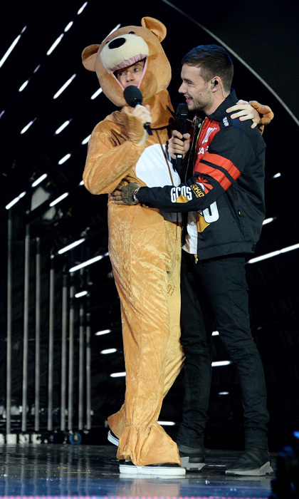 Bear hug! Radio host Nick Grimshaw made Liam Payne feel right at home in the absence of his son Bear during the BBC Radio 1 Teen Awards on October 22 in London. The <i>Bedroom Floor</i> singer was a good sport as his friend and host showered him with love during the event.