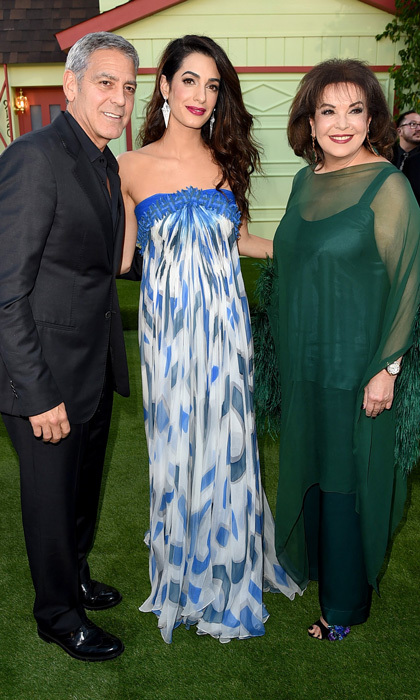 George Clooney was joined at the Los Angeles premiere of his new film <i>Suburbicon</i> by his leading lady, wife Amal. The mom-of-two stunned wearing a strapless blue and white maxi dress. 