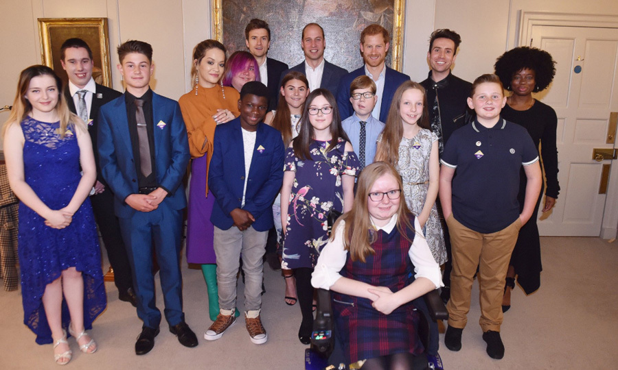 Prince Harry, Prince William, Nick Grimshaw and Rita Ora posed with this year's Radio One Teen Heroes recipients during a reception in Kensington Palace on October 20. 