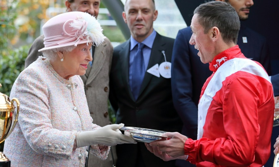 "Queen Elizabeth was all smiles as she presented jockey Frankie Dettori with the winner's prize for the Queen Elizabeth ll Stakes at the weekend sporting event. Frankie later said: ""I had a nice chat with Her Majesty, it was a good day all round.""