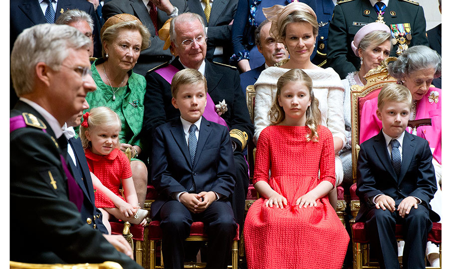 Princess Elisabeth, front row second from right, is pictured here at her grandfather King Albert II's abdication – the former king is seated behind the young princess and her siblings, between wife Queen Paola and daughter-in-law Mathilde – on July 21, 2013. On the same day her father Crown Prince Philippe, on left, became the new monarch. 