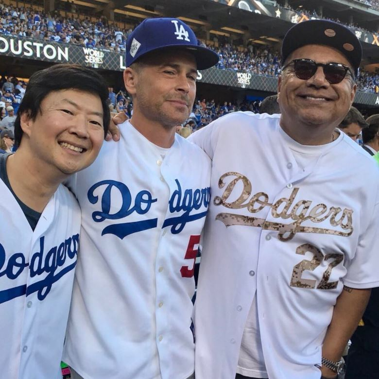 Ken Jeong shared this photo with Rob Lowe and George Lopez in their Dodgers gear on his Instagram. The <i>Hangoer</i> actor took his turn waving the flag and going wild for the fans ahead of game one. 