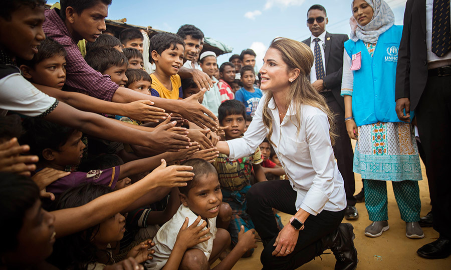 A global advocate for the health and wellbeing for children, Queen Rania of Jordan shook hands with young Rohingya Muslim refugees during her visit to the Kutupalong camp in Ukhia, Bangladesh on October 23.