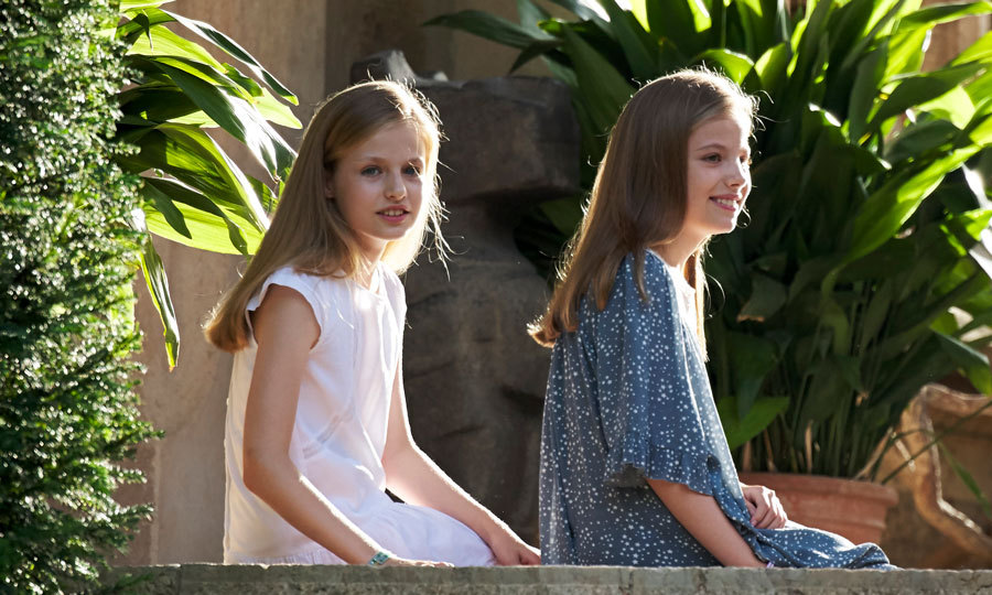 The royal sister duo took a break from their family summer photocall together at Marivent Palace in Mallorca in July 2017. Princess Leonor wore a white lace dress while her sister Sofia complemented her in a three-quarter sleeved blue floral lace dress.