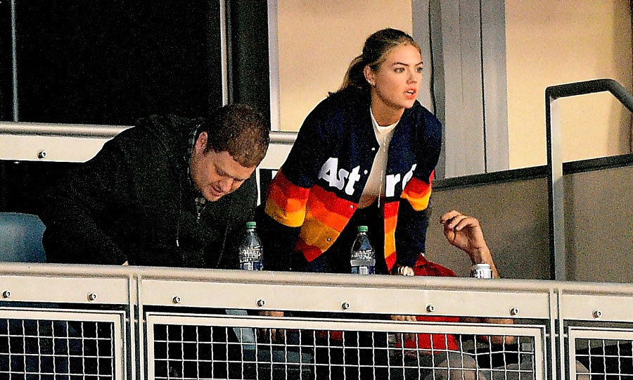 Kate Upton kept her eyes peeled on the Dodgers vs. Astros game back in Los Angeles. The model wore an Astros jacket while she watched from a box.
