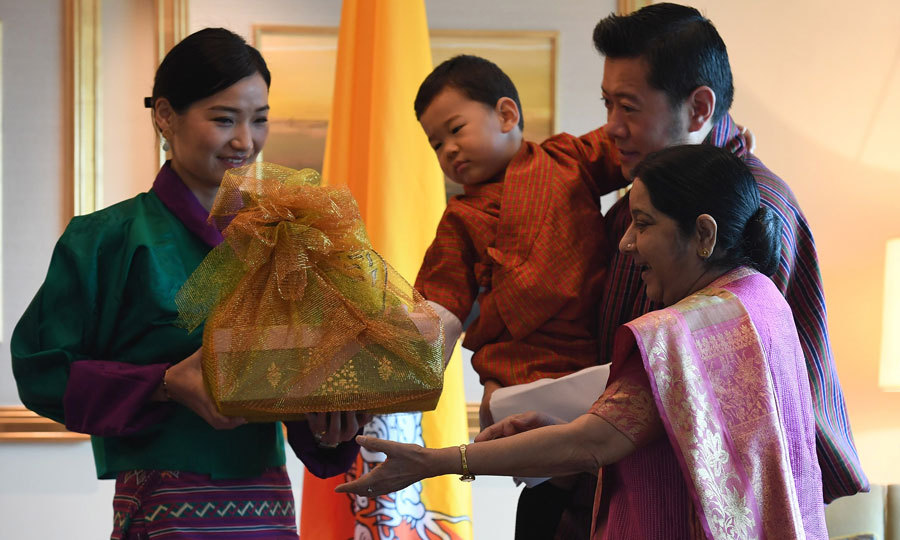 What's in the basket?! A curious Prince Jigme checked out a gift that the Bhutan royal family received upon arrival in India from Indian Foreign Minister Sushma Swaraj. 