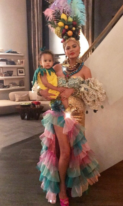Chrissy Teigen and daughter Luna Legend coordinated this Halloween. The cookbook author fittingly dressed as Carmen Miranda with her and John's baby girl dressing as a pineapple.