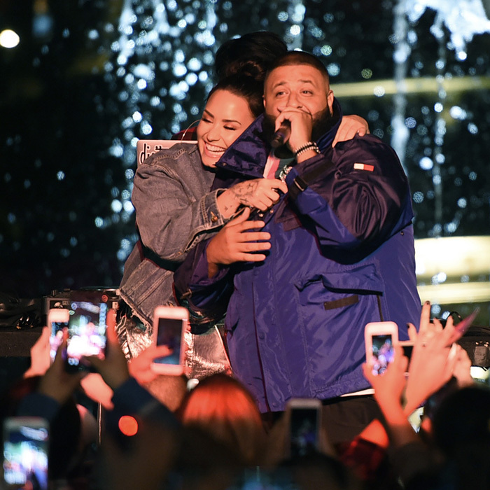 Demi Lovato and DJ Khaled had plenty of love to go around during their Fan Luv event held at The Grove in Los Angeles on November 2. The Disney alum alum performed her hit <i>Sorry Not Sorry</i>, while DJ Khaled treated fans to a performance of <i>Wild Thoughts</i>. The pair's entrance to the event, which celebrated their tour, included a marching band, double decker trolley, and Rolls-Royce.