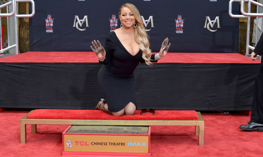 Mariah Carey wasn't too much of a diva to get her hands dirty while being honored at her Hand and Footprint Ceremony at the TCL Chinese Theatre in Hollywood. The <i>Touch My Body</i> singer had boyfriend Bryan Tanaka and BFF Lee Daniels on hand to support her during the event.