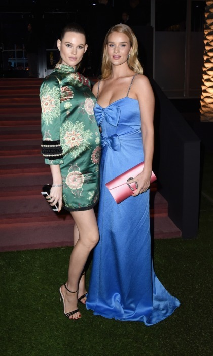 Also in Gucci were model friends Behati Prinsloo and Rosie Huntington-Whiteley. Behati showed off her growing baby bump in a silk slip that had an intricate floral pattern and pearl detailing at the sleeves. Meanwhile, Rosie went with a double-bowed periwinkle dress and pink clutch.