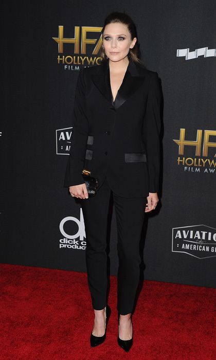 Elizabeth Olsen also wore a powersuit on the Hollywood Film Awards carpet. The <i>Avengers</i> actress wore a black Dolce & Gabbana tuxedo with Jimmy Choo pumps.