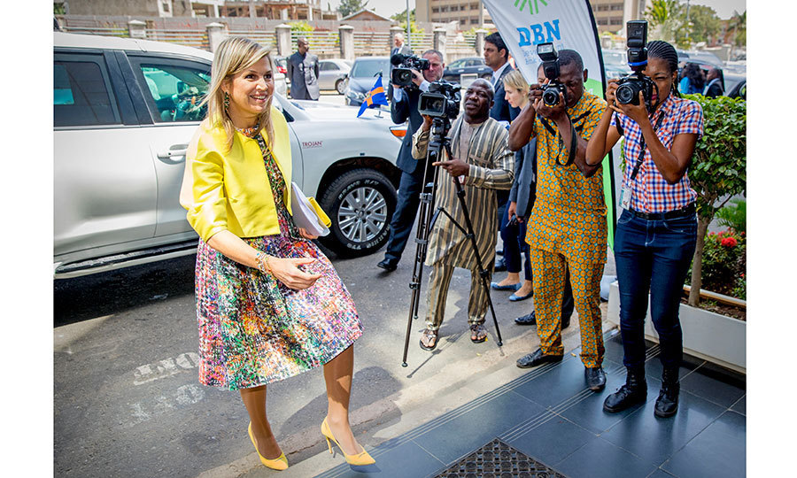 Queen Maxima was ready for her close-up, greeted by photographers as she headed to the UN office in Abuja, Nigeria on November 1. The royal was in the African country for a three-day visit.