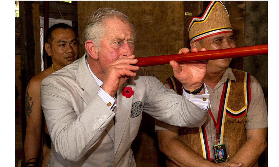 Prince Charles took aim with a blowgun during a visit to the Sarawak Cultural Village on November 6, 2017 in Kuching, Malaysia. The British royal and wife Camilla, Duchess of Cornwall are on a tour of Singapore, Malaysia, Brunei and India.
