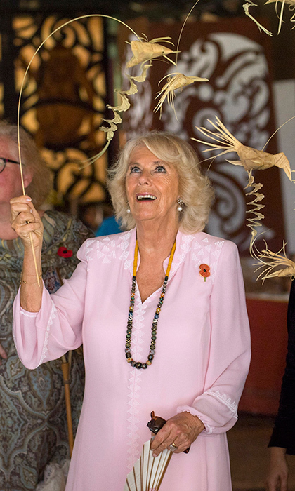 Meanwhile, also at the Sarawak Cultural Village, where visitors are encouraged to learn through engaging with culture, Duchess Camilla was hands on with some local crafts.
