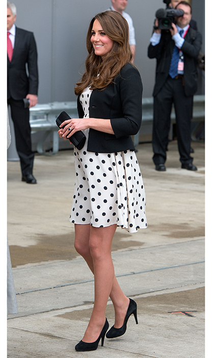 The pregnant royal wore a polka-dot dress from Topshop for a visit to the Warner Bros studios with Prince William and Prince Harry on April 26, 2013. The royal trio was able to visit the set of the <I>Harry Potter</I> movies during the magical trip to the studio in Watford, England. 
