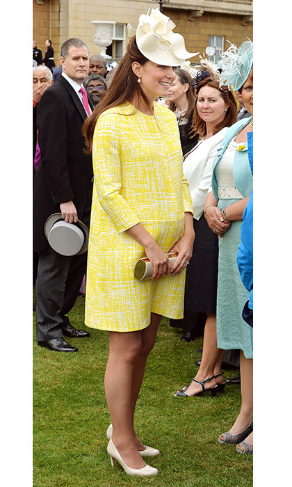 Bright sight: The Duchess of Cambridge wowed the crowds in a yellow Emilia Wickstead coat dress at Queen Elizabeth II's garden party on May 22, 2013. The sunny look was perfect for the Buckingham Palace gathering. 