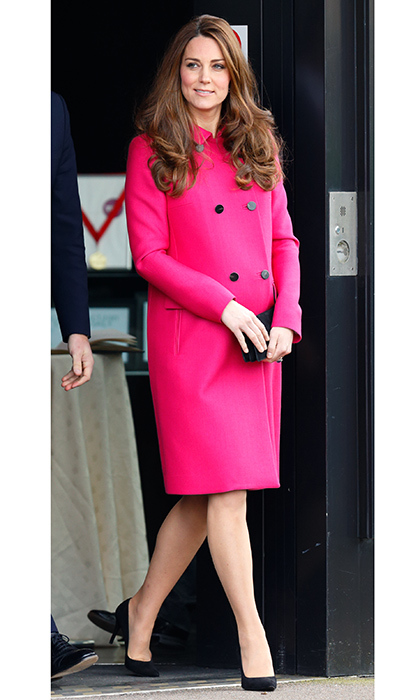 Just over a month before Princess Charlotte's birth, Duchess Kate was looking great! For an engagement at the Stephen Lawrence Center on March 27, 2015 Kate recycled her bold fuchsia coat by British brand Mulberry.