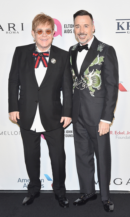 "The Elton John AIDS Foundation celebrated its 25th year at its annual gala on November 7. A number of stars including Sting, Billy Joel, Hilaria Baldwin, Glenn Close and more came out to pay tribute to the foundation's famous founder for his philanthropic endeavors and humanitarian work. ""I'm not very good at receiving awards. There's still so much work to be done. Give me an award when it's all over. It's very nice. I'm very proud of the foundation. I'm very proud of what we've achieved,"" Elton John said. ""Hopefully in another ten years this will be over. We have the medicine to make this disease go away, we just have to make the stigma go away and pull people together as a human entity.""
