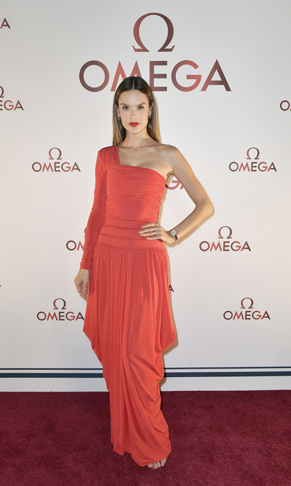 Alessandra Ambrosio wore a draped Antonio Berardi gown to the Omega Aqua Terra Collection launch party in Miami. The <i>Daddy's Home 2</i> actress opted for a sleek do and a red lip to finish her look.