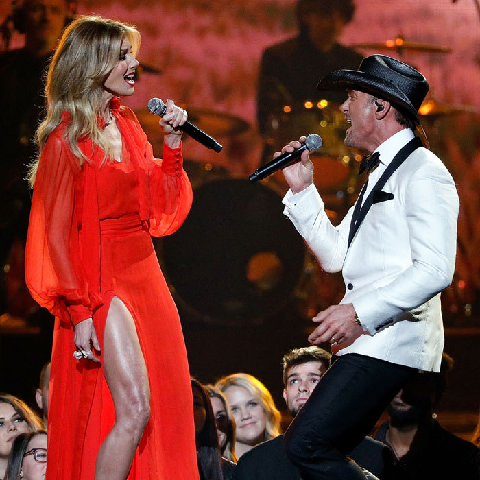 The <i>Soul2Soul</i> couple performed face to face during the CMAs. Faith Hill, who showed off a toned leg in her red dress, and husband Tim McGraw sang their new single <i>The Rest of Our Life</i> together. 