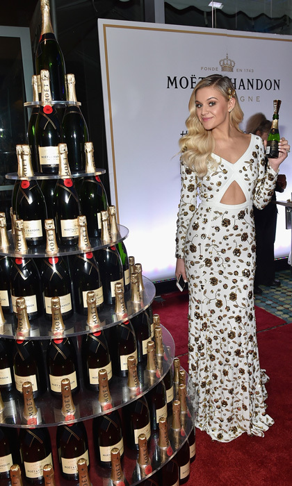 Kelsea Ballerini, in Michael Kors Collection with gold floral embellishments, had the perfect way to celebrate the 51st CMA Awards - with Moët & Chandon. 
