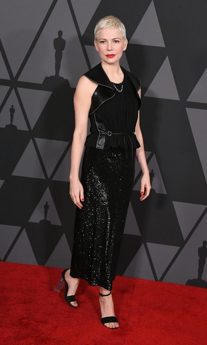 Work it! Walking the carpet in a shiny Louis Vuitton number, Michelle Williams looked like a chic dream. The star accented her black attire with bright red lipstick.