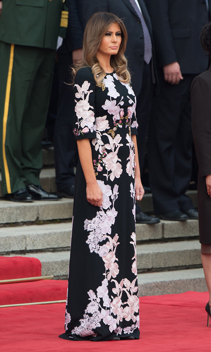 First Lady Melania Trump made a floral statement on November 9 stepping out in a floor length dress by Dolce & Gabbana for a welcome ceremony at the Great Hall of the People in Beijing.