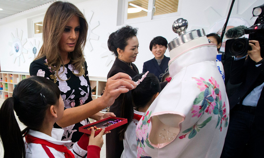 "While visiting a primary school in Beijing with China's First Lady Peng Liyuan, Melania dropped by a fashion class where she admired a student's traditional dress design. ""I enjoy fashion. Beautiful job,"" the former model said. The student told Melania, ""I want to make beautiful clothes,"" to which the American president's wife replied, ""Yes, beautiful. Study hard, and make your dreams come true.""
