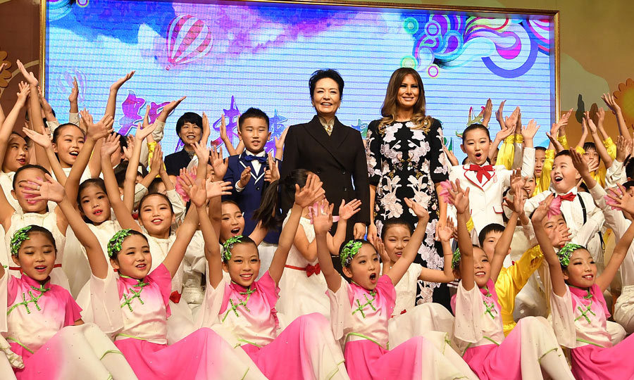 Melania and China's First Lady Peng Liyuan attended a cultural performance at a primary school in Beijing. The two women entered the room to the theme song from La La Land before watching a traditional Chinese dance and choral performance.