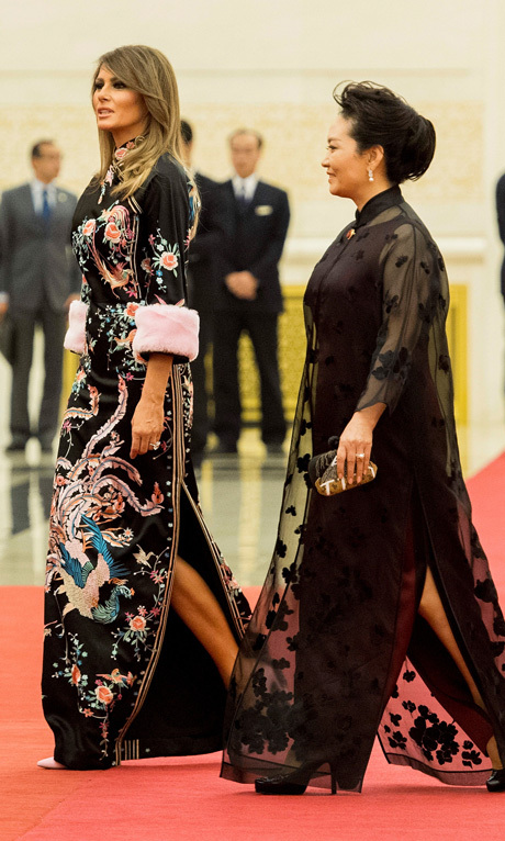 The first lady changed later in the day for the state dinner held at the Great Hall of the People. Melania stunned wearing a Chinese-inspired dress by Gucci. The floral number features an embroidered mandarin collar and pastel pink fur cuffs. Barron Trump's mother straightened her hair for the dinner on November 9.