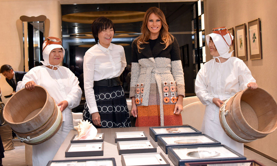 Melania reunited with Japan's First Lady Akie Abe on the first day of her tour of Japan. The pair met with divers during their visit to the Mikimoto Pearl head shop in the Ginza district of Tokyo on November 5.
