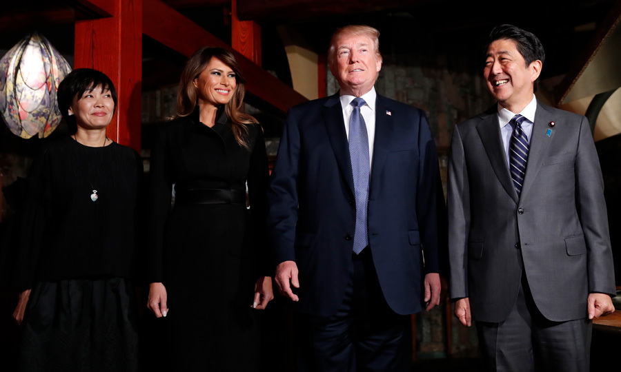 The president and his wife were all smiles as they posed beside Japan's Prime Minister Shinzo Abe and Akie Abe at a restaurant in Tokyo on November 5. The group enjoyed a private couples dinner at Ukai-Tei. Ivanka Trump's stepmother swapped her Fendi coat for an evening black coat for the occasion.