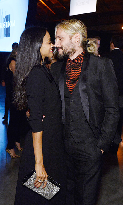 Parents-of-three Zoe Saldana and Marco Perego made the most of their evening out together and were looking cozy during the Baby2Baby bash. 