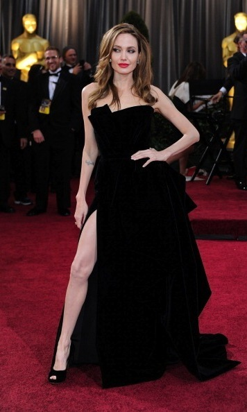When Angelina Jolie pops her right leg out of her dress, the world takes notice. After her 2012 Oscar appearance, when she and husband Brad Pitt arrived as the red carpet coverage was wrapping up, her leg became a part of pop culture history. It even had a Twitter account dedicated to it and screenwriter Jim Rash paid tribute to it when he accepted an Oscar for writing The Descendants.