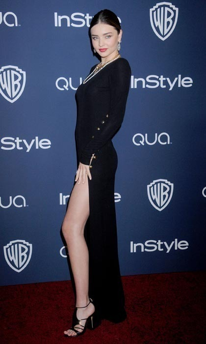 Supermodel Miranda Kerr couldn't hide much at the 2014 Golden Globes, decked out in a low-slung gown with a slit that flaunted her show-stopping legs.