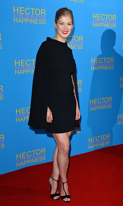 Elegant in a black cape dress at the London premiere of Hector and the Search for Happiness.