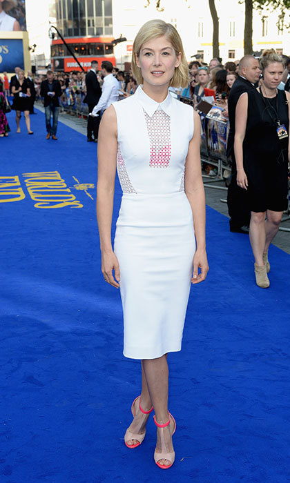 At the World's End world premiere in London in a white dress with colorful detail, accented with some nude peep toe stilettos with neon pink detail.