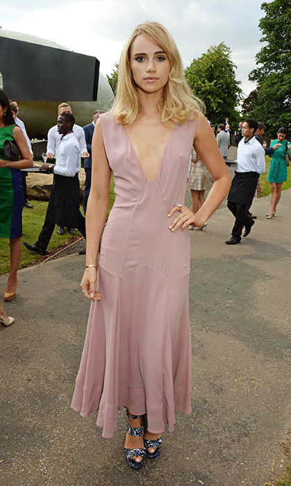Taking the plunge: Suki wears a muted blush dress for an outdoor event.