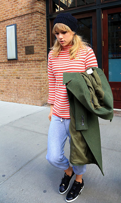 Suki goes for ease and comfort in a striped shirt, simple baggy pants and sneakers.