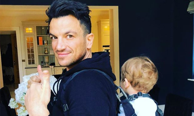 Peter Andre carrying baby Theo