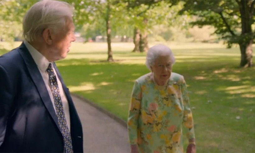 David Attenborough walking with Queen