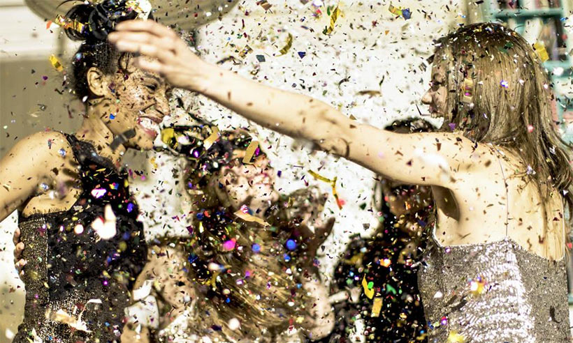 women-throwing-glitter-party