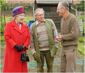 The Queen chats with gardening enthusiasts on a visit to an allotment in East London