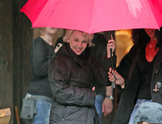 Kylie braves the rain on set in South Wales