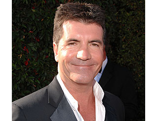 Simon Cowell spends £1milion on two cars