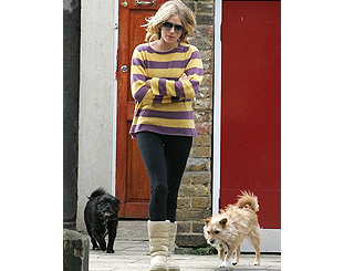 Sienna takes her pooches for a stroll