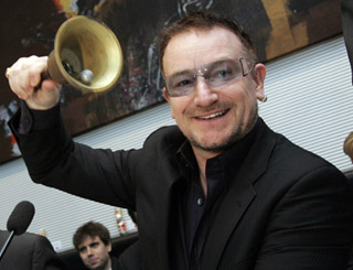 Bono ringing the bell for change